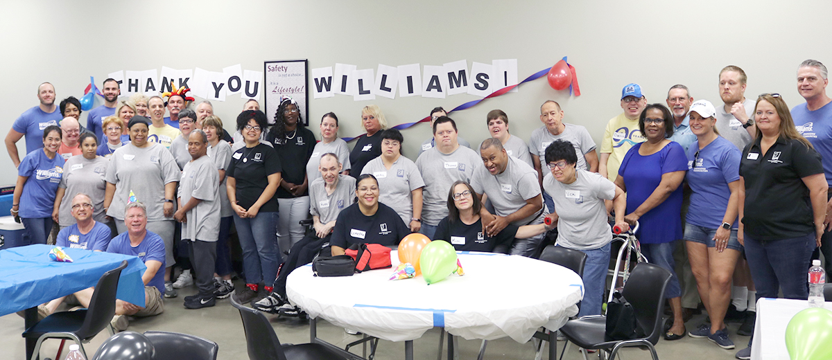 Volunteers from Williams Company with supported workers and Goodwill staff at Goodwill Contract Services on United Way Day of Caring 2019.